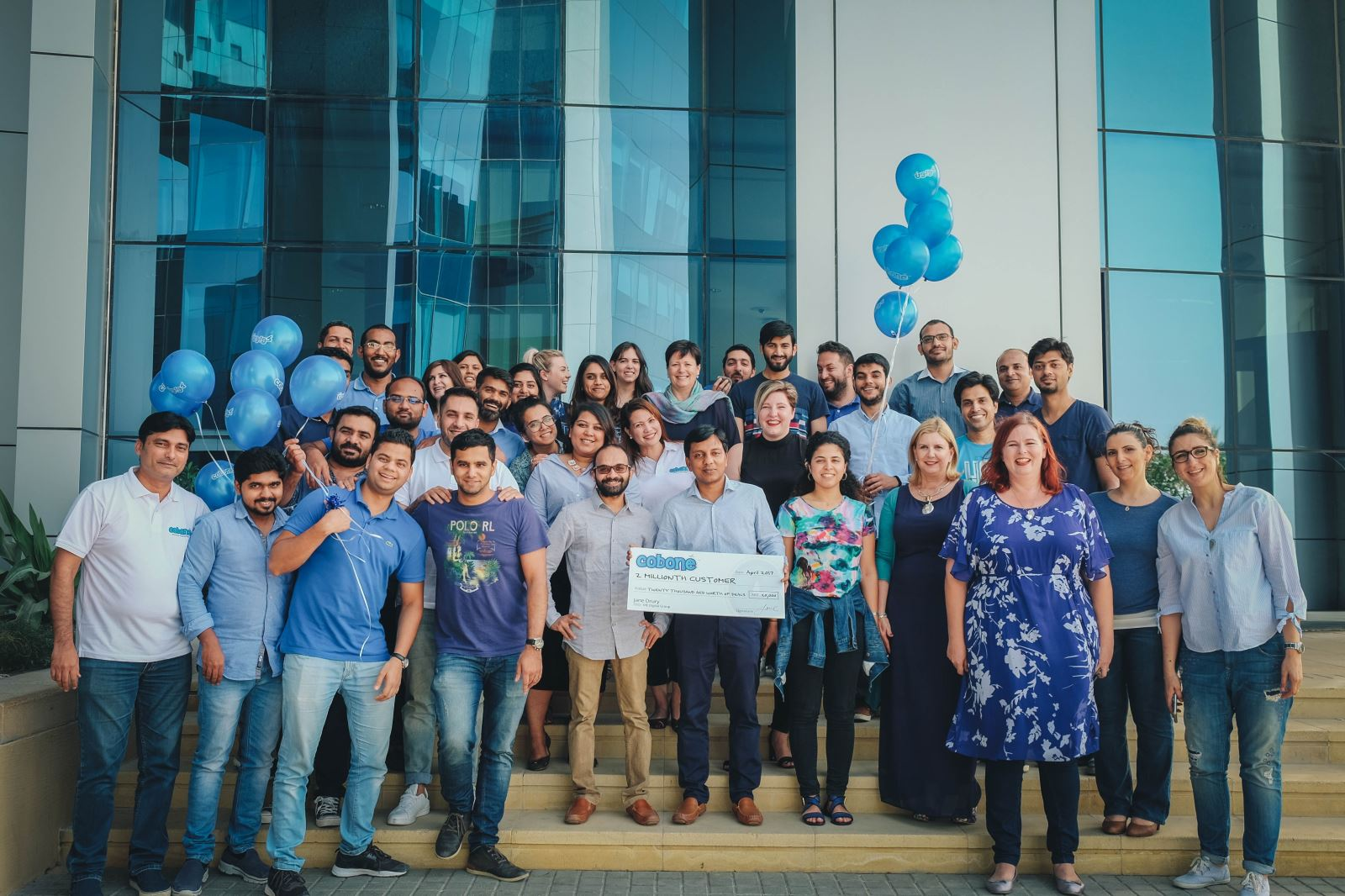 Cobone Dubai team and 2 millionth customer