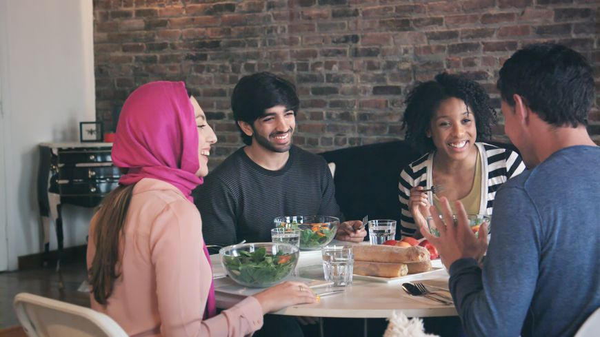 mixed cultures dining together