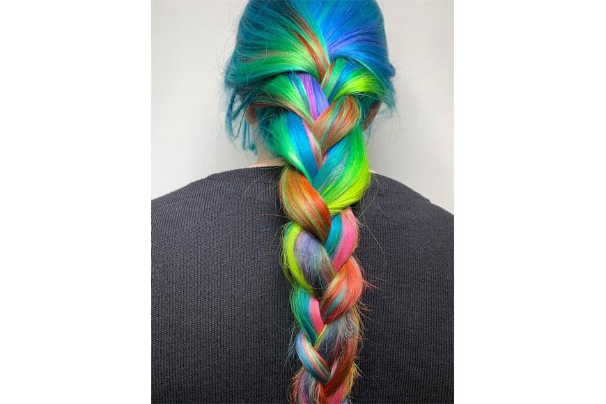 A colourful braid hair style created by Bleach London
