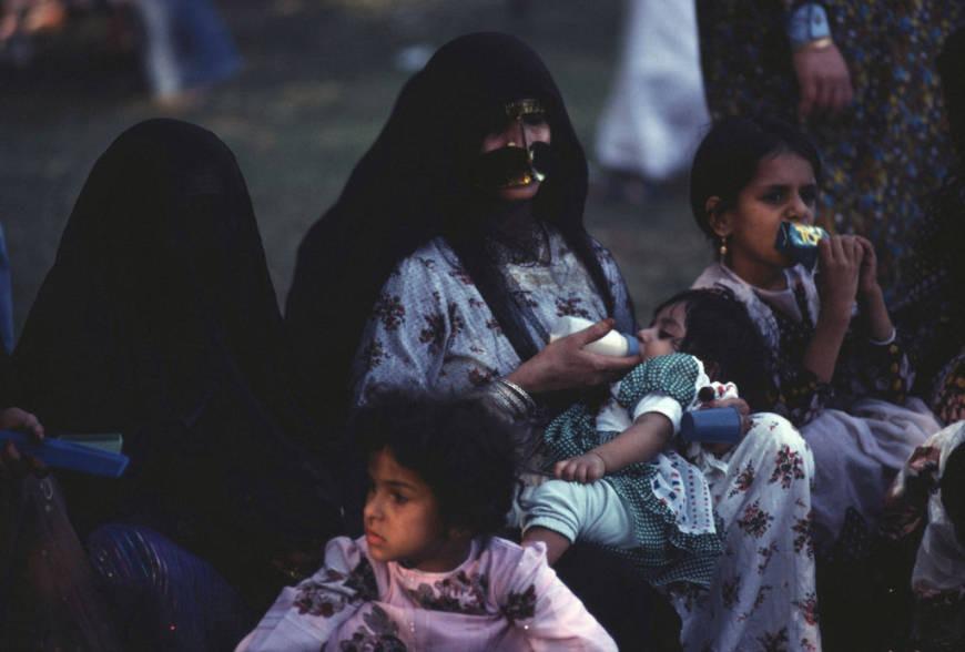 Emirati mother feeding child in Abu Dhabi history
