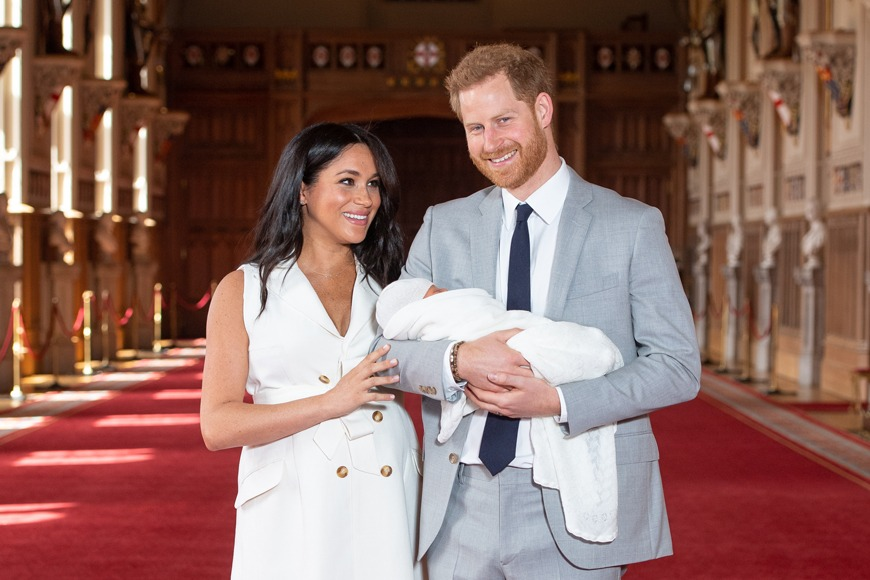 Meghan and Harry present Archie to the world a few days after his birth (Dominic Lipinski/PA)
