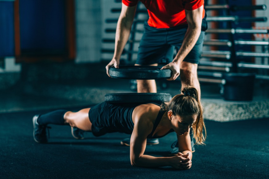 Have a qualified PT guide you safely through any weighted plank exercises