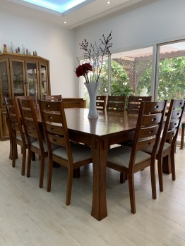 Hardwood dining table with 10 chairs