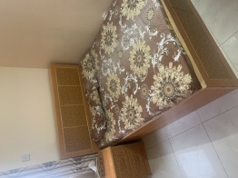 Personally furnished bed with 1 side table and medicated mattress