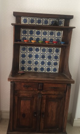 Lovely wood cabinet with blue/white tile feature