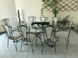 Elegant Glass Table with 8 wrought iron padded chairs