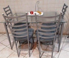 Glass kitchen table with four chairs