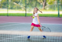 Children learning tennis