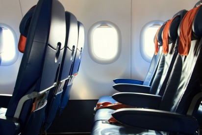 Who Gets to Use the Armrests on a Plane?