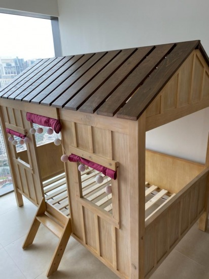 Wooden house bed